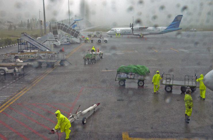 ilustrasi bandara hujan - nalar.id